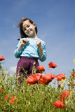 Little girl in the corn poppy Stock Photos