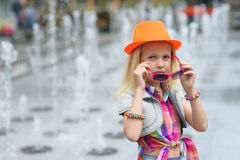 Little girl corrects sunglasses Royalty Free Stock Image
