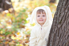 Little girl in costume bunny in the autumn forest Royalty Free Stock Photos