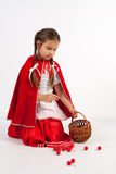 Little girl in a costume, collect cherries Stock Images