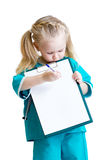 Little girl in costume of doctor takes notes Royalty Free Stock Images