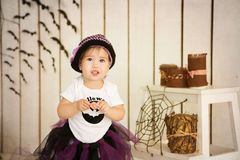 Little girl in costume Halloween witch on a holiday. Little girl in costume Halloween witch  on a holiday Royalty Free Stock Image