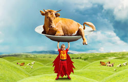 Little girl in costume holding a big cow Stock Images