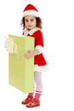 Little girl in costume of Santa Claus with gift Stock Image
