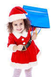 Little girl in costume of Santa Claus with Stock Images
