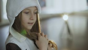 Little girl in costume of snow girl posing at camera. In hall. Full HD stock footage