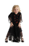 Little girl in costume of a witch Royalty Free Stock Photos