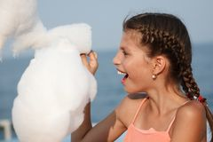 Little girl with cotton candy Stock Photo