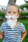 Little girl with cotton candy Royalty Free Stock Images