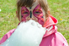 Little girl with cotton candy. Little girl with with face painting Royalty Free Stock Images