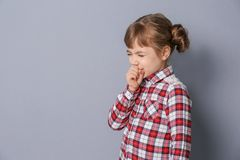 Little girl coughing on   background. Little girl coughing on grey background Royalty Free Stock Photo