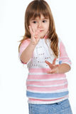 Little girl counting fingers Royalty Free Stock Image