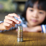 Little girl counts his coins Royalty Free Stock Photos