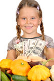 Little girl counts money and vegetables Royalty Free Stock Photo