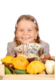 Little girl counts money and vegetables Royalty Free Stock Image
