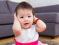 Little girl cover her ear Royalty Free Stock Photography