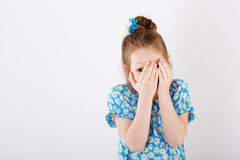 The little girl covered her face Stock Photography
