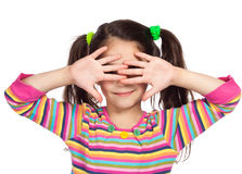 Little girl with covered his eyes Stock Image
