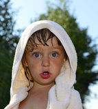 Little girl covered with towel Stock Images