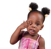 Little girl covering eye. Pretty African American little girl covering one eye Stock Image