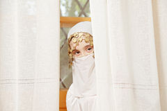 Little girl covering face hiding Royalty Free Stock Photos