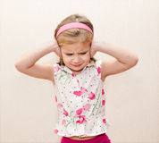 Little girl covering her ears Royalty Free Stock Image