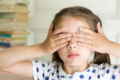 Little girl covering her eyes with hands Royalty Free Stock Photos