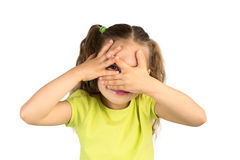 Little Girl Covering Her Eyes, Watching Through the Gap Stock Photos