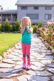 Little girl covering her face, does not want be Royalty Free Stock Image