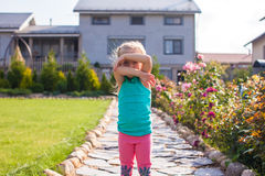 Little girl covering her face, does not want be Stock Images