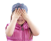 Little girl covers facewith hands. Little girl covers a face with hands on white Stock Images
