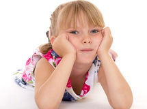 Little girl covers her head. Royalty Free Stock Image