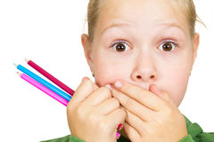 Little girl covers her mouth with her hands Stock Photos