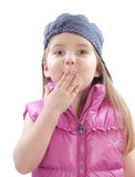 Little girl covers a mouth. With hand on white Royalty Free Stock Images
