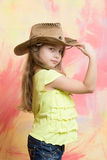 Little girl in cowboy or cowgirl outfit with hat Stock Image