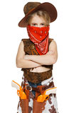 Little girl cowboy standing with folded hands Royalty Free Stock Images