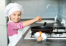 Little girl cracking an egg Royalty Free Stock Photos
