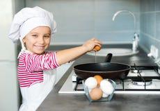 Little girl cracking an egg Royalty Free Stock Photos