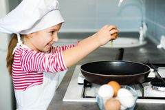 Little girl cracking an egg Royalty Free Stock Images