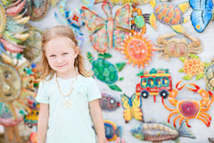 Little girl at crafts market Royalty Free Stock Photos