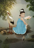 Little girl, crane and fish stock image