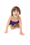 Little girl crawling on the floor Stock Images