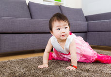 Little girl crawling Stock Photos