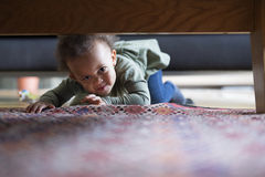 Little girl crawling at home. Royalty Free Stock Photo
