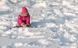 Little girl crawling on snow Stock Photography