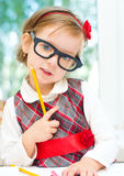 Little girl with crayon Stock Image
