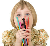 Little girl with crayons. On the white background Royalty Free Stock Image