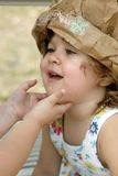 Little Girl in Crazy Hat Stock Images