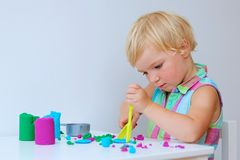 Little girl creating with modeling compound Stock Photo