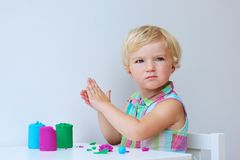 Little girl creating with modeling compound Royalty Free Stock Photos